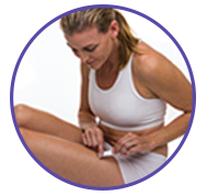 Woman applying transdermal Estrogen Gel to her upper thigh.